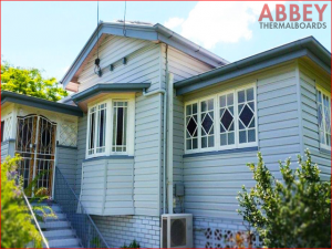 House Exterior after Modern Insulated Vinyl Cladding - Abbey Thermalboards
