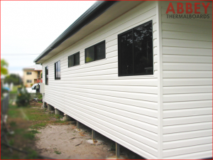 Vinyl Cladding over House External After. Modern Stylish - Abbey Thermalboards