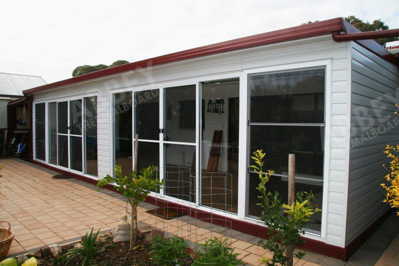 White cladding completed on this series of housing units.