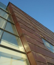 Interesting copper cladding design used in creative exterior cladding.