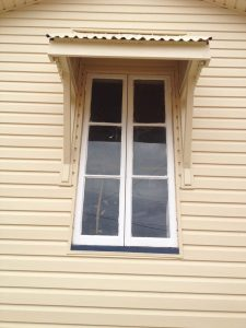 House cladding applied to a window frame on a Gladstone house.