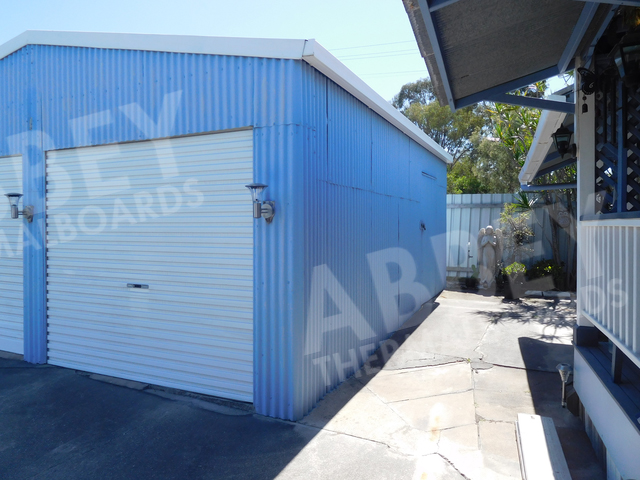 Blue shed with cladding completed.