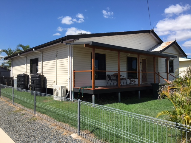 A completed vinyl cladding job on a Brisbane house, taken from the back of the property.